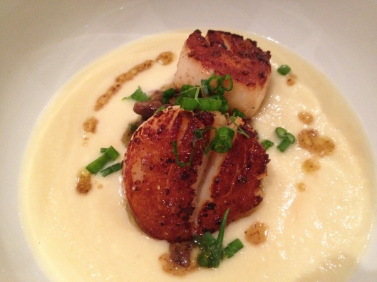 scallops sauteed in brown butter with mushroom pickle served over a coliflour & leek potage